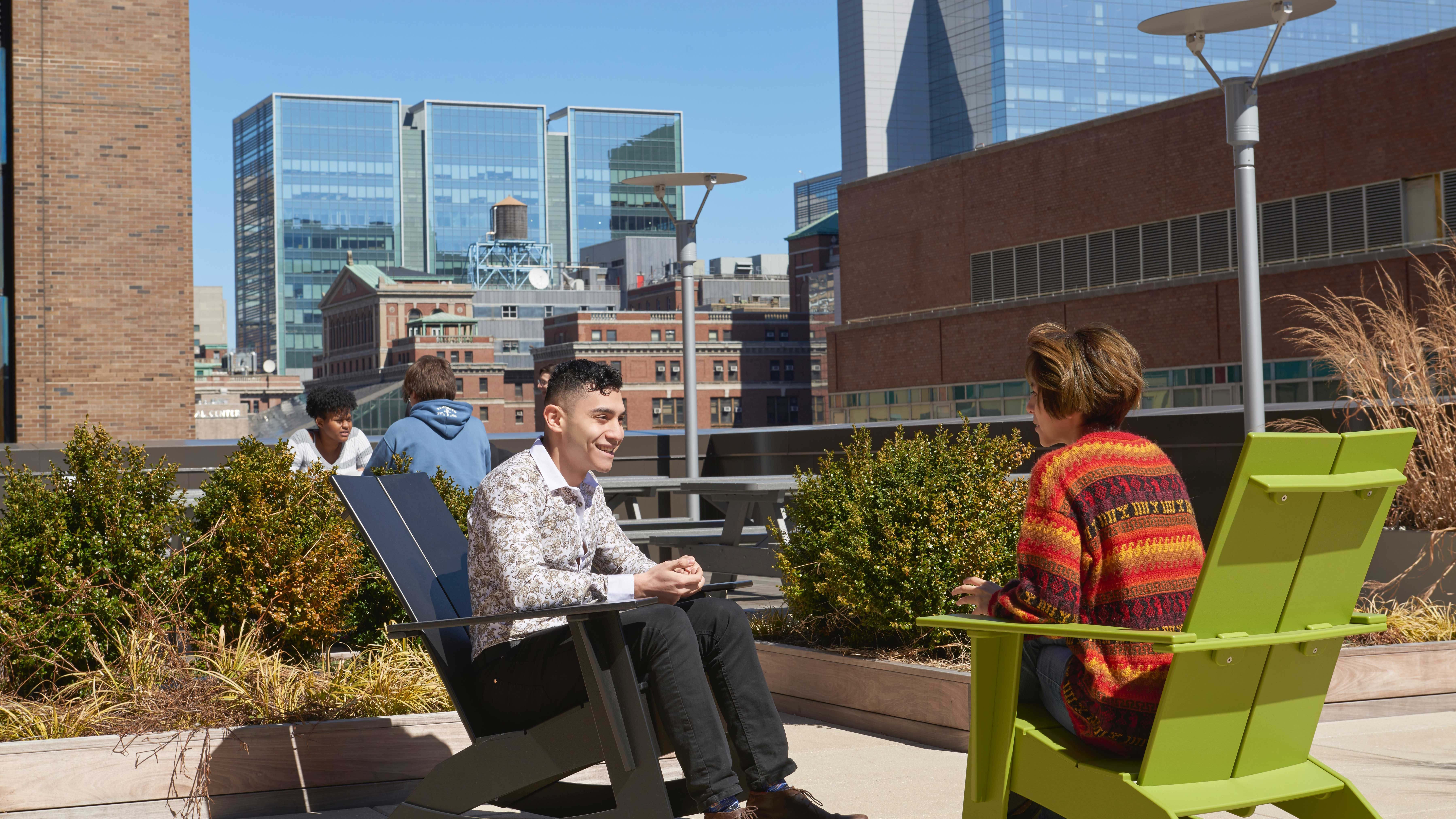 Students enjoying the terrace at the 24th Street Residence