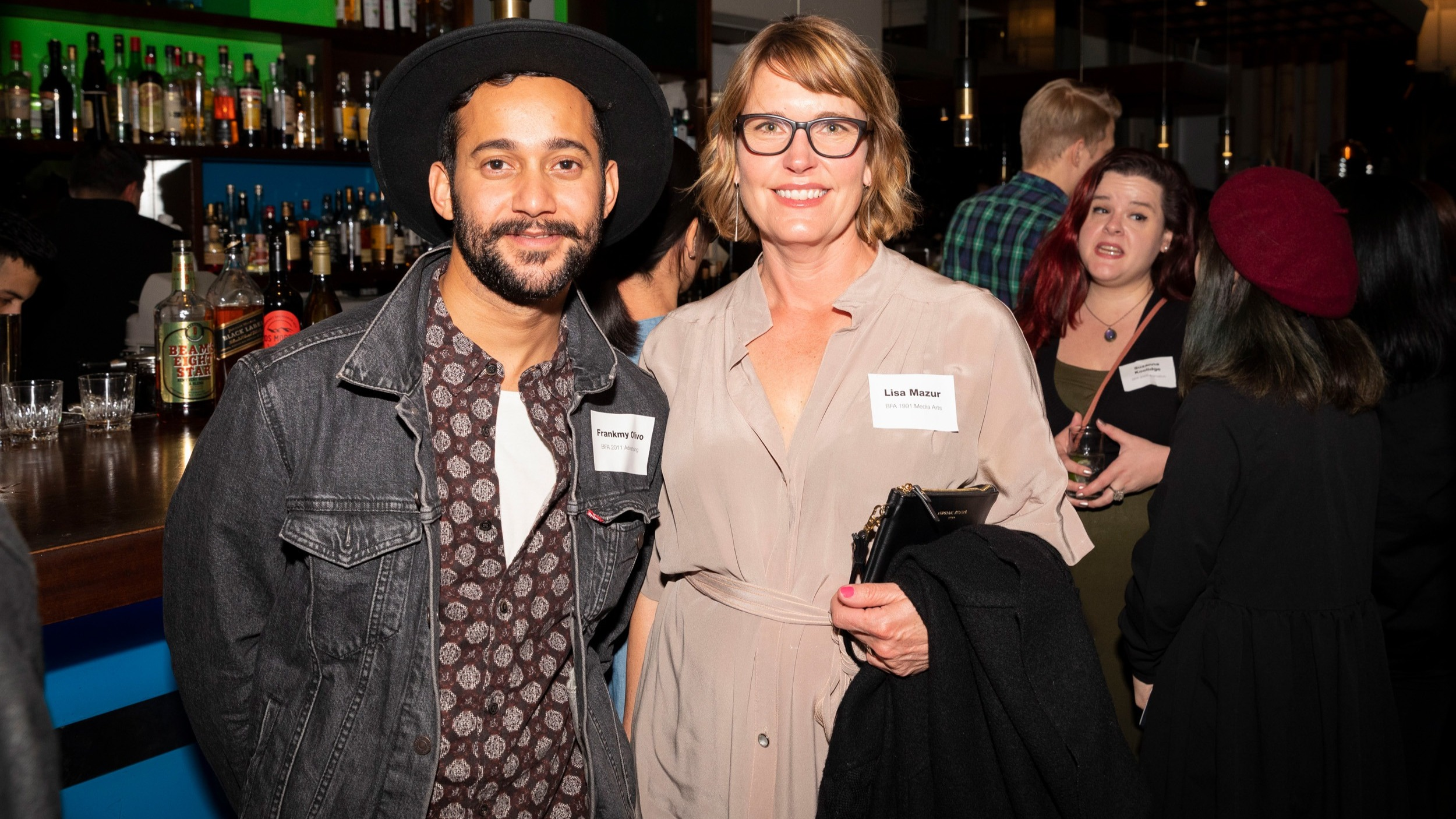 Two SVA alumni at a networking event in San Francisco.