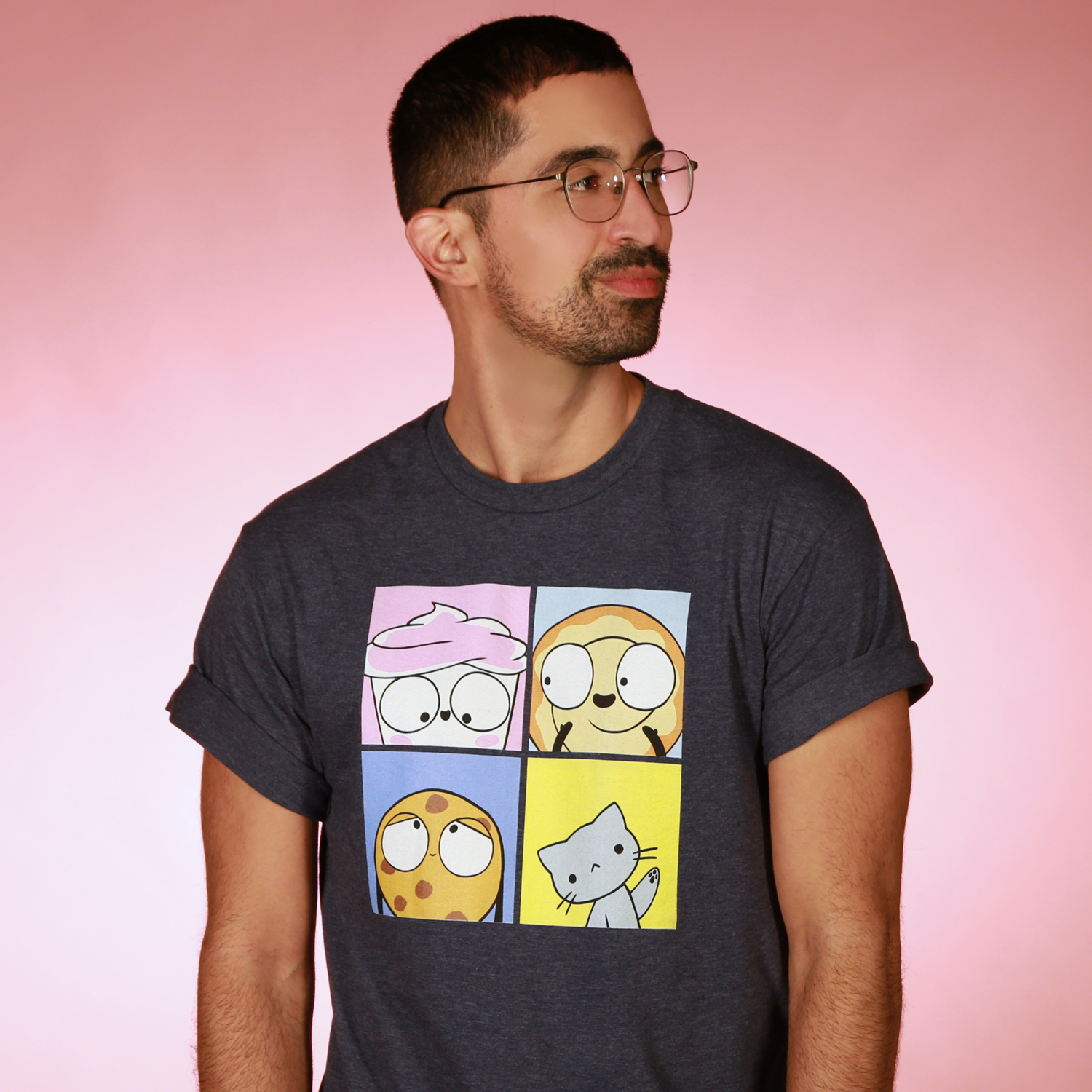 A photograph of a man in a T-shirt featuring characters from the Good Advice Cupcake brand.