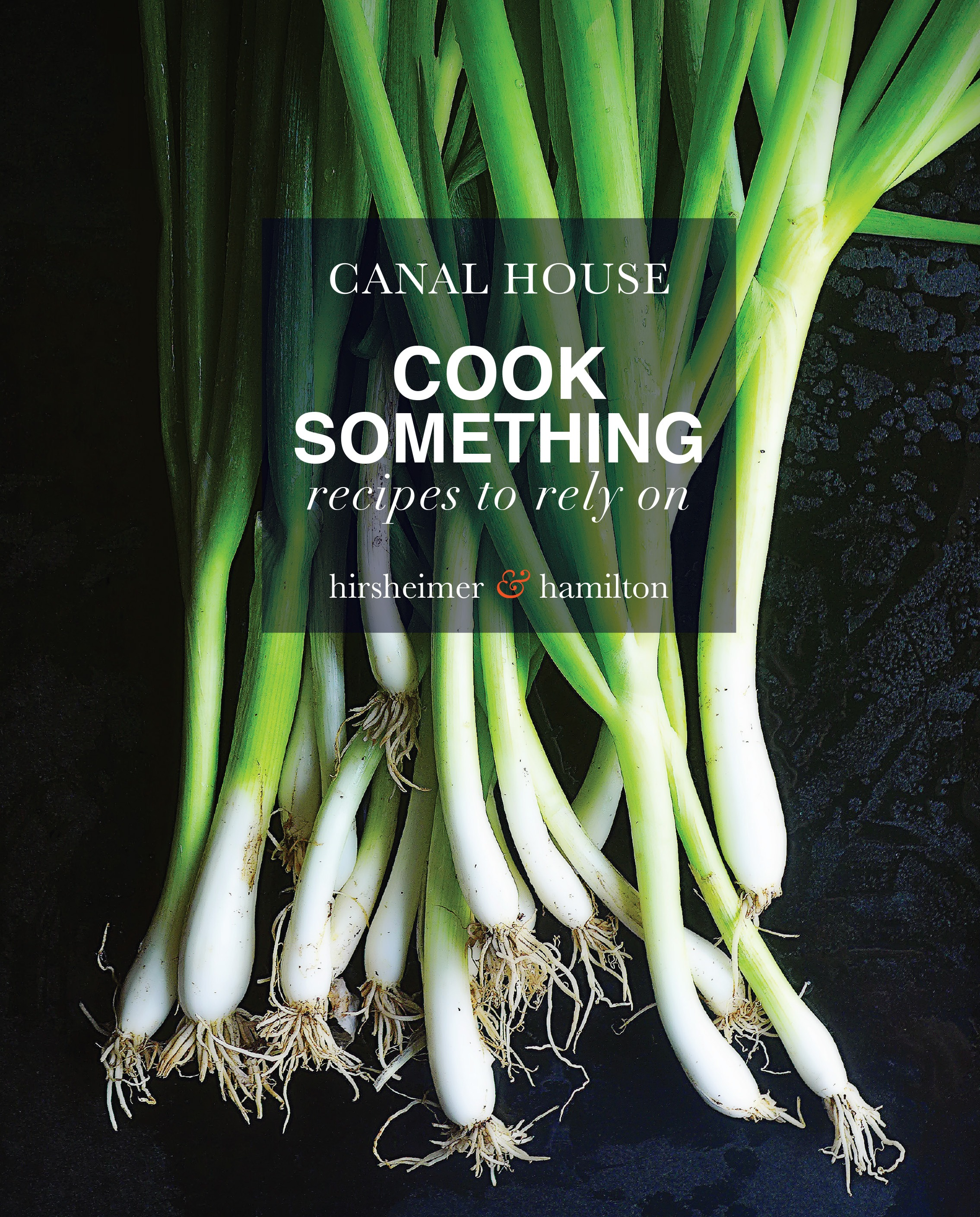 A book cover featuring a photograph of green onions.