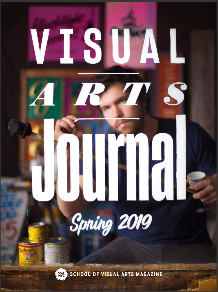 A magazine cover featuring a photograph of a sign painter at work. He is painting the magazine's title on a pane of glass between himself and the camera.
