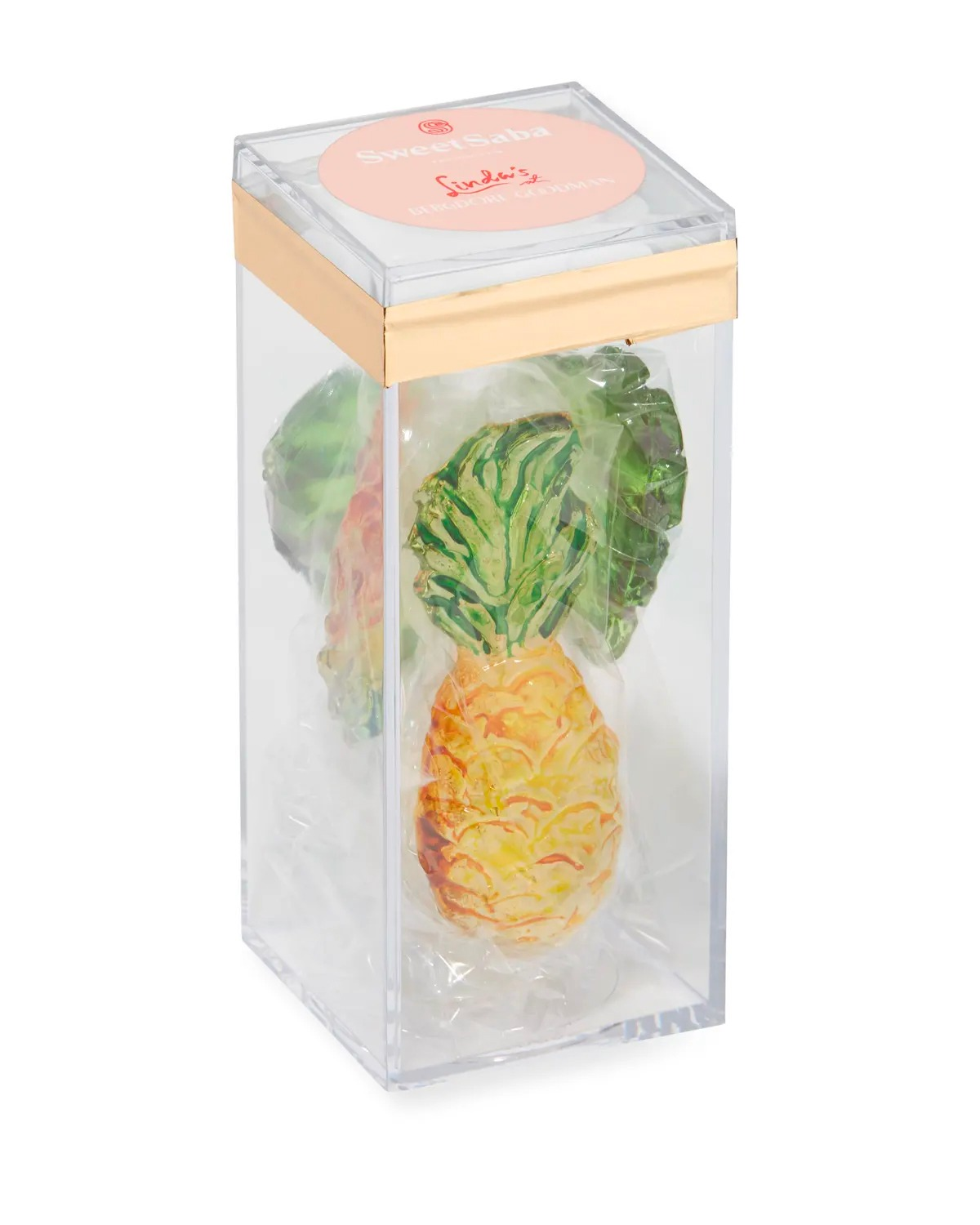 A photograph of a candy pineapple in a clear jewelry box.