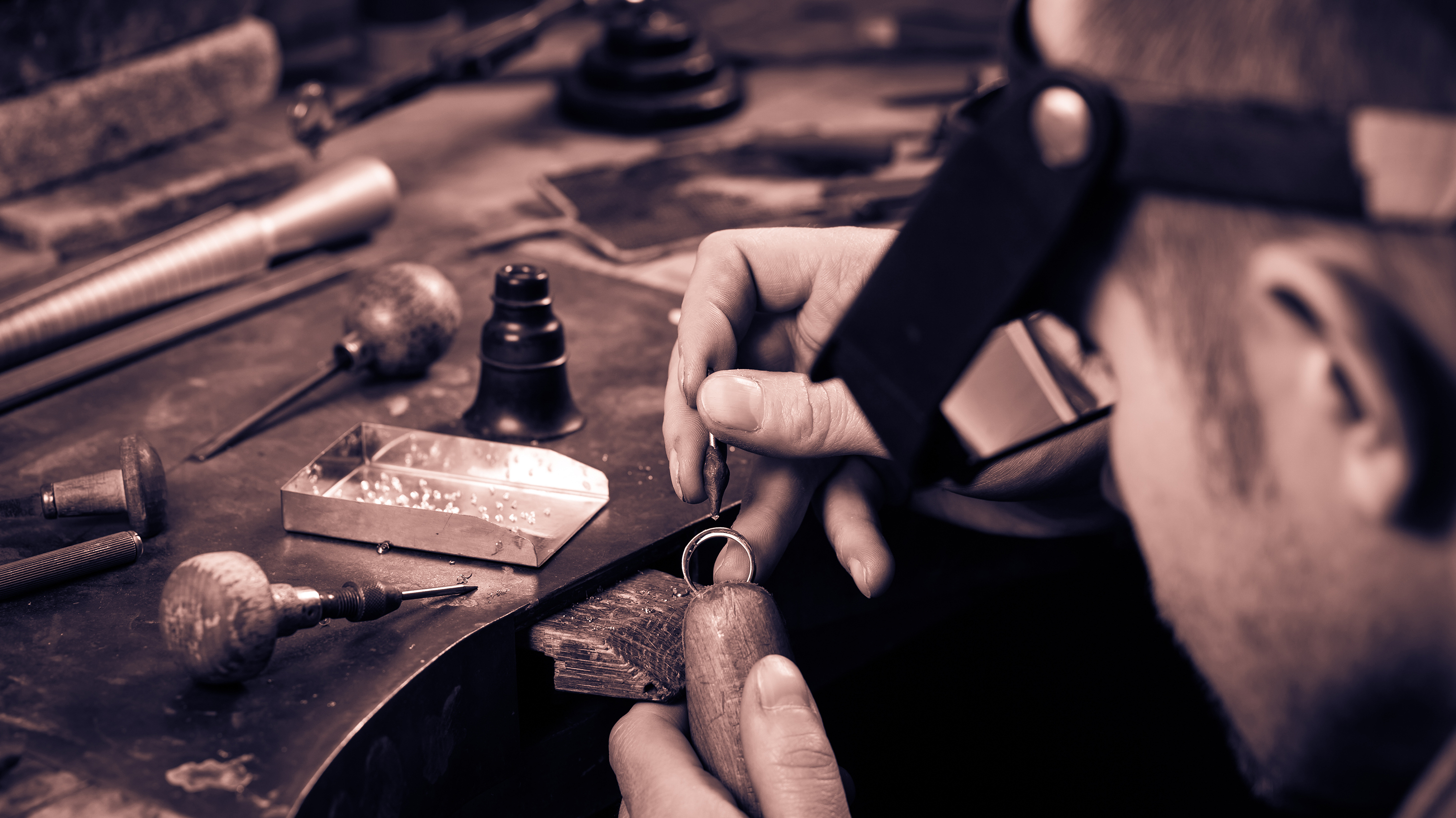 person working on jewelry