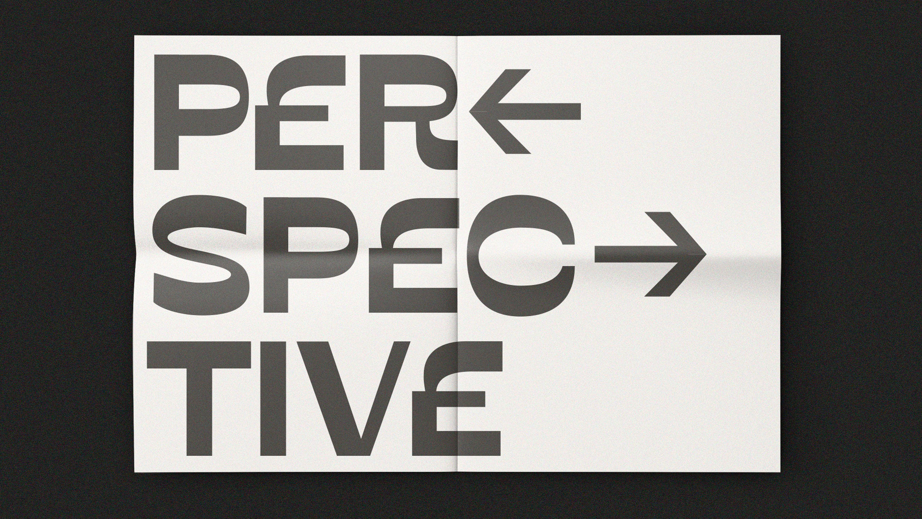 """The word """"Perspective"""" written in smooth sans-serif black font across three lines and two pieces of paper with arrows pointing in and out of the word fragments."""