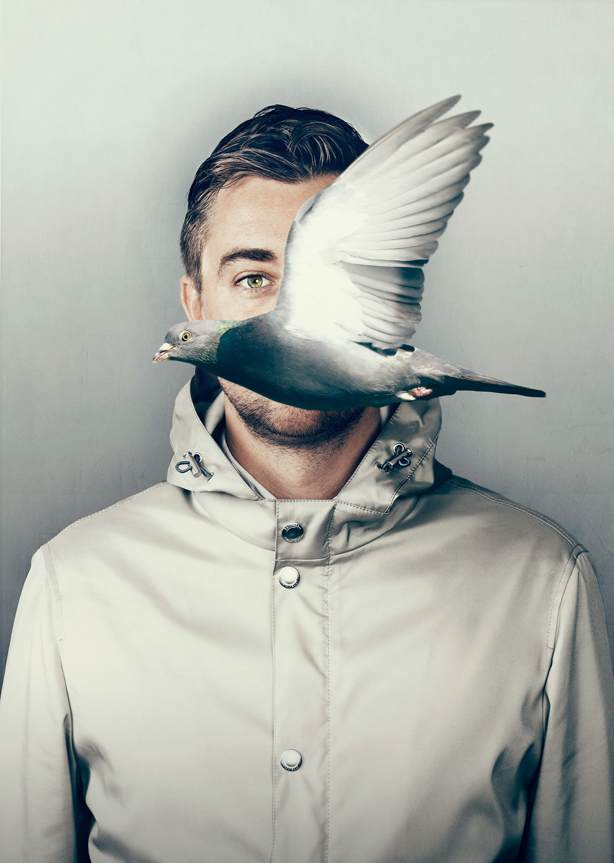 An image of a man with a pigeon flying in front of him.