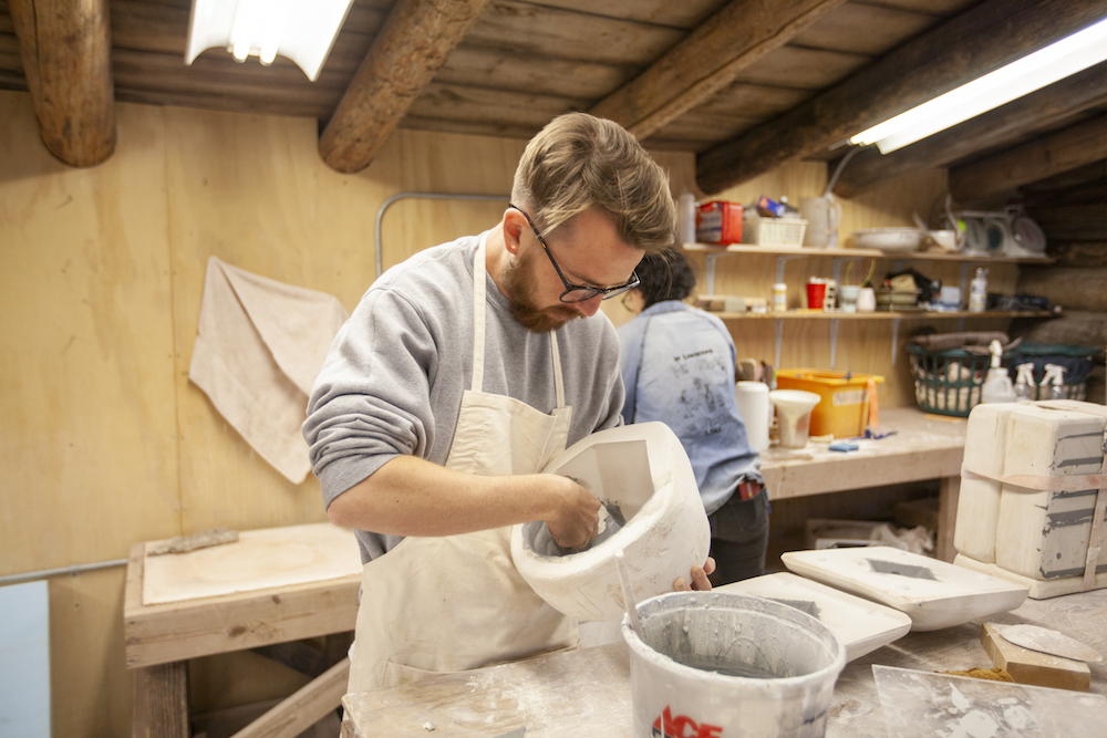 A man works on a ceramic piece in one of Anderson Ranch's workshops.