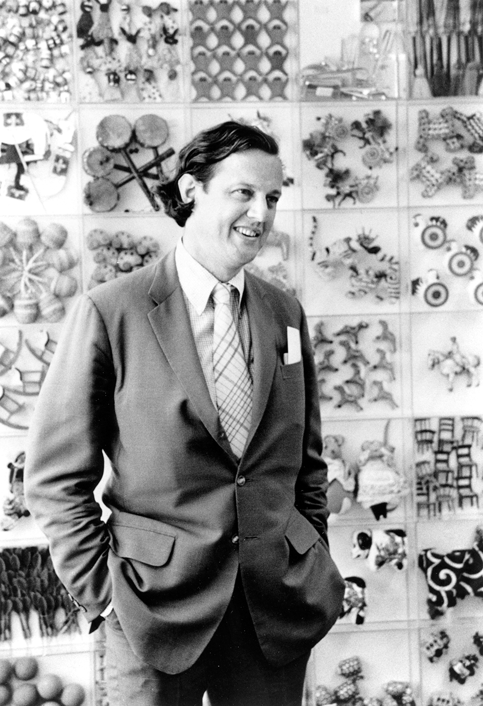A man standing and smiling before color photographs where invented.