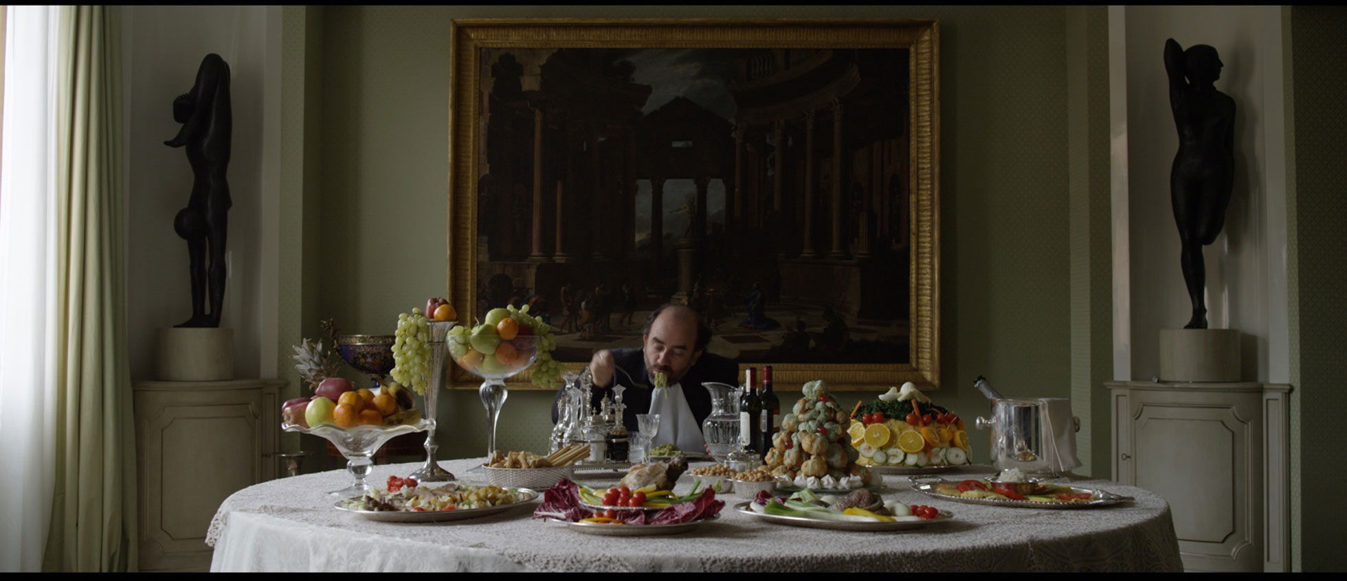 a wealthy man having an extravagant dinner