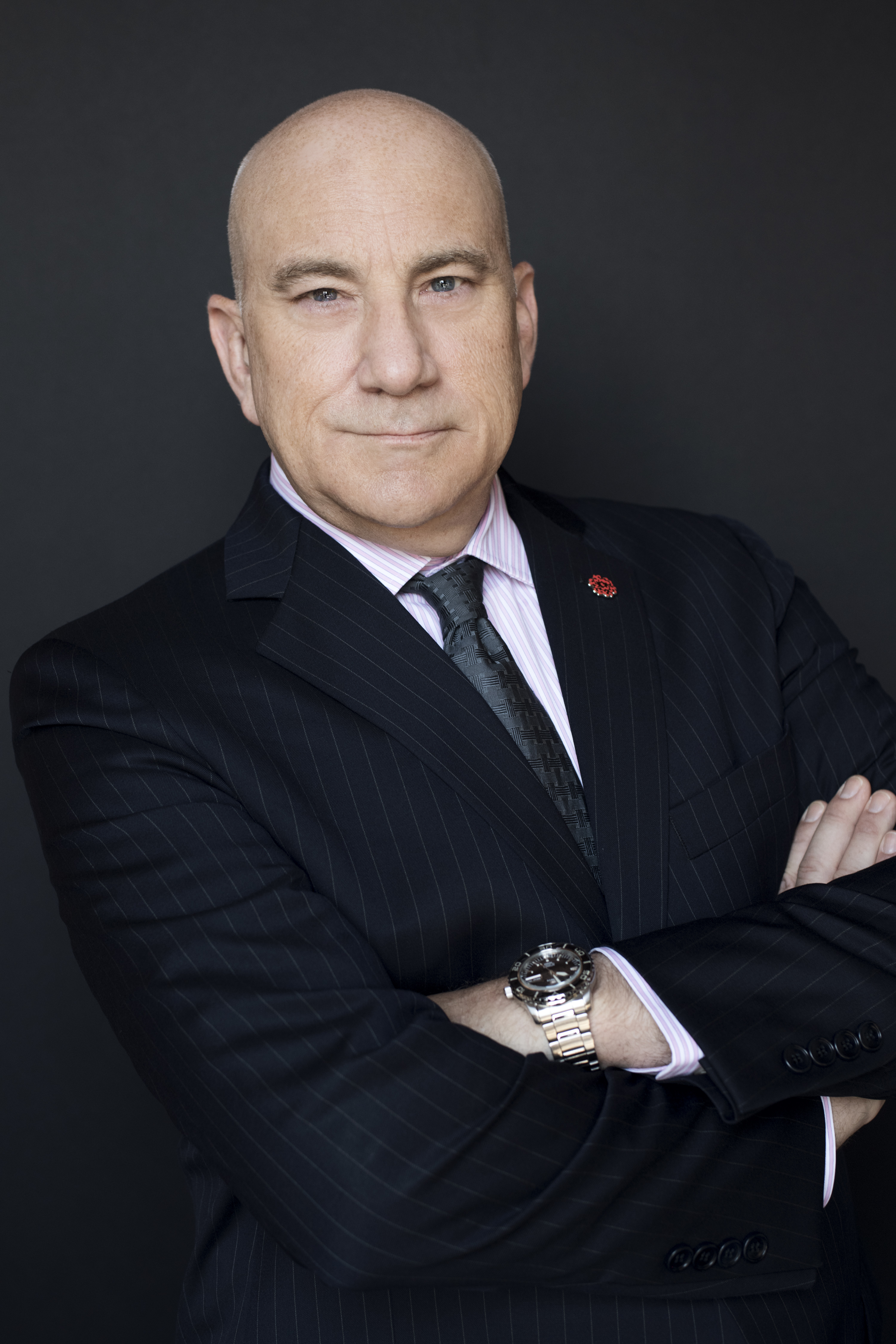 """A photograph of the new provost Dr. Christopher J. Cyphers by Nir Arieli.<span class=""""redactor-invisible-space""""></span>"""