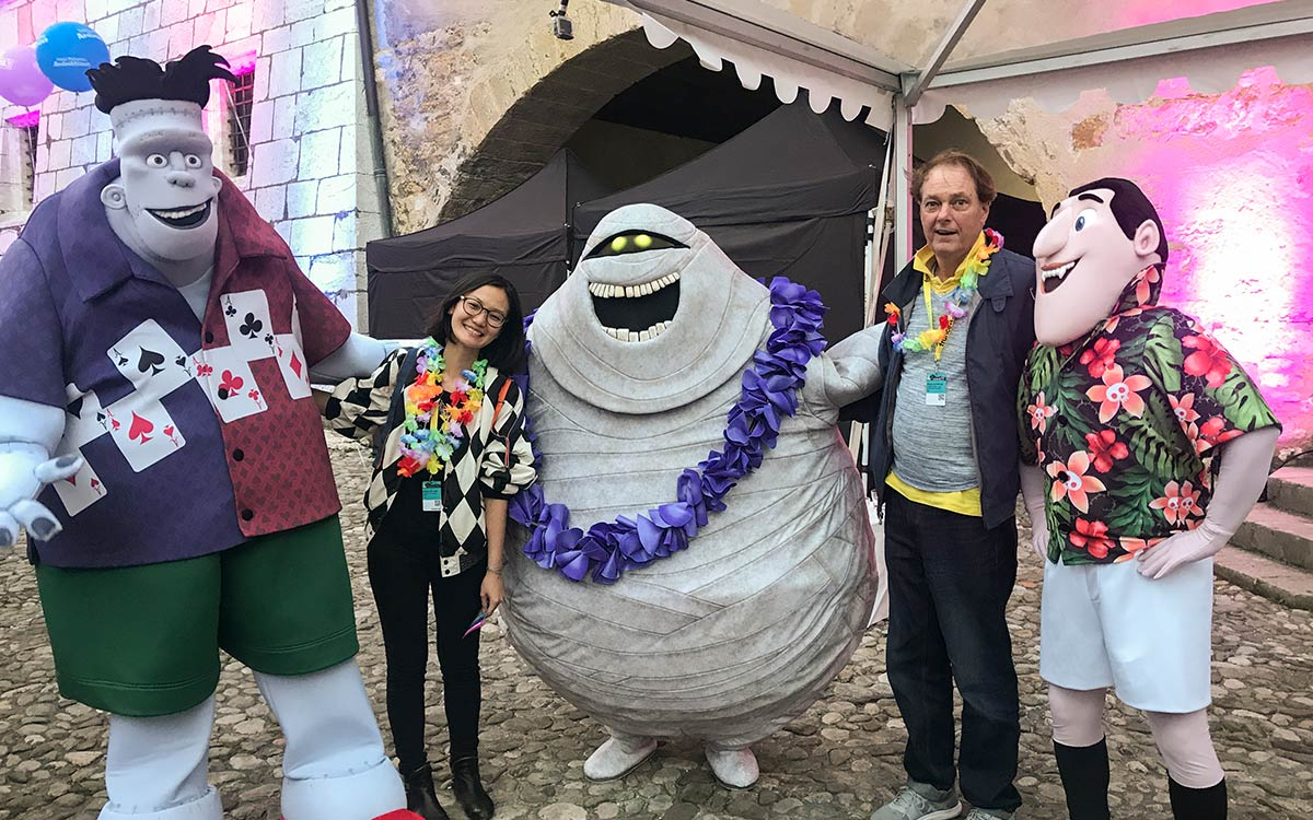 A photo of faculty and Director of Operations in MFA Computer Arts Hsiang Chin Moe and animator Bill Plympton celebrating with Sony Animation at the <em>Hotel Transylvania 3</em> launch.