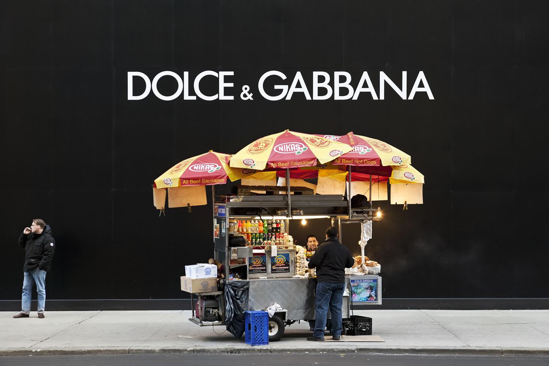 Food cart vendor on sidewalk outside of Dolce & Gannana.