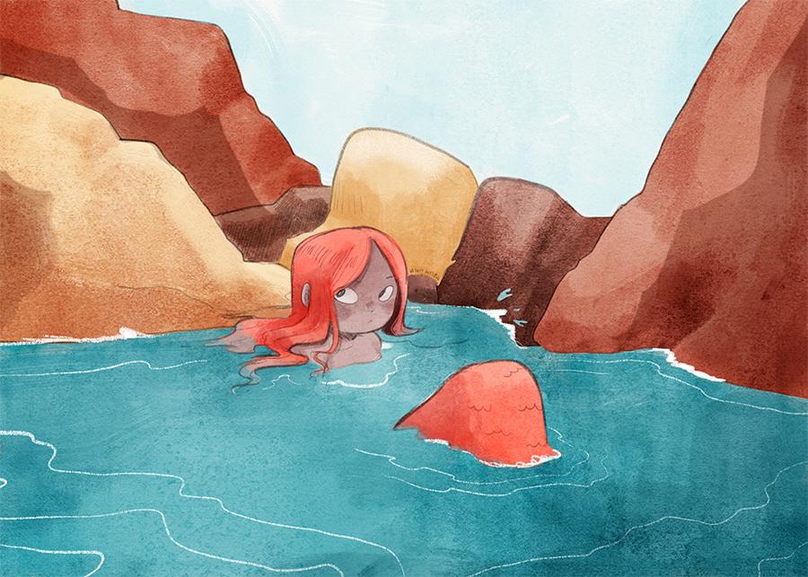 A mermaid swims near some rocks.