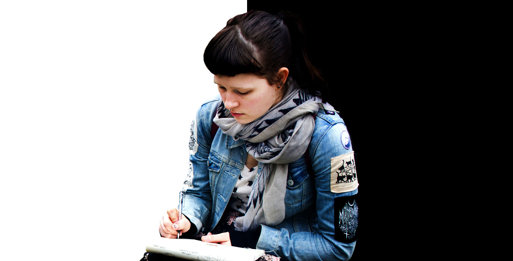 A girl sitting and writting