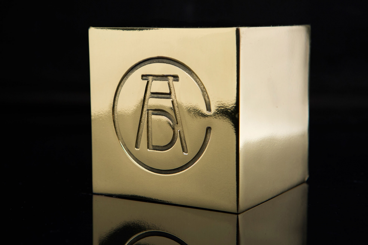 Gold block with logo on it.