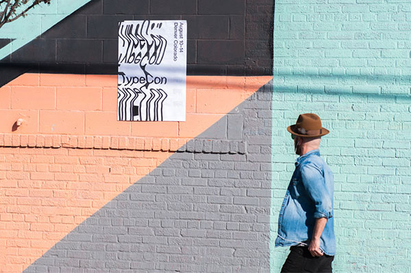 A man admiring some street art.
