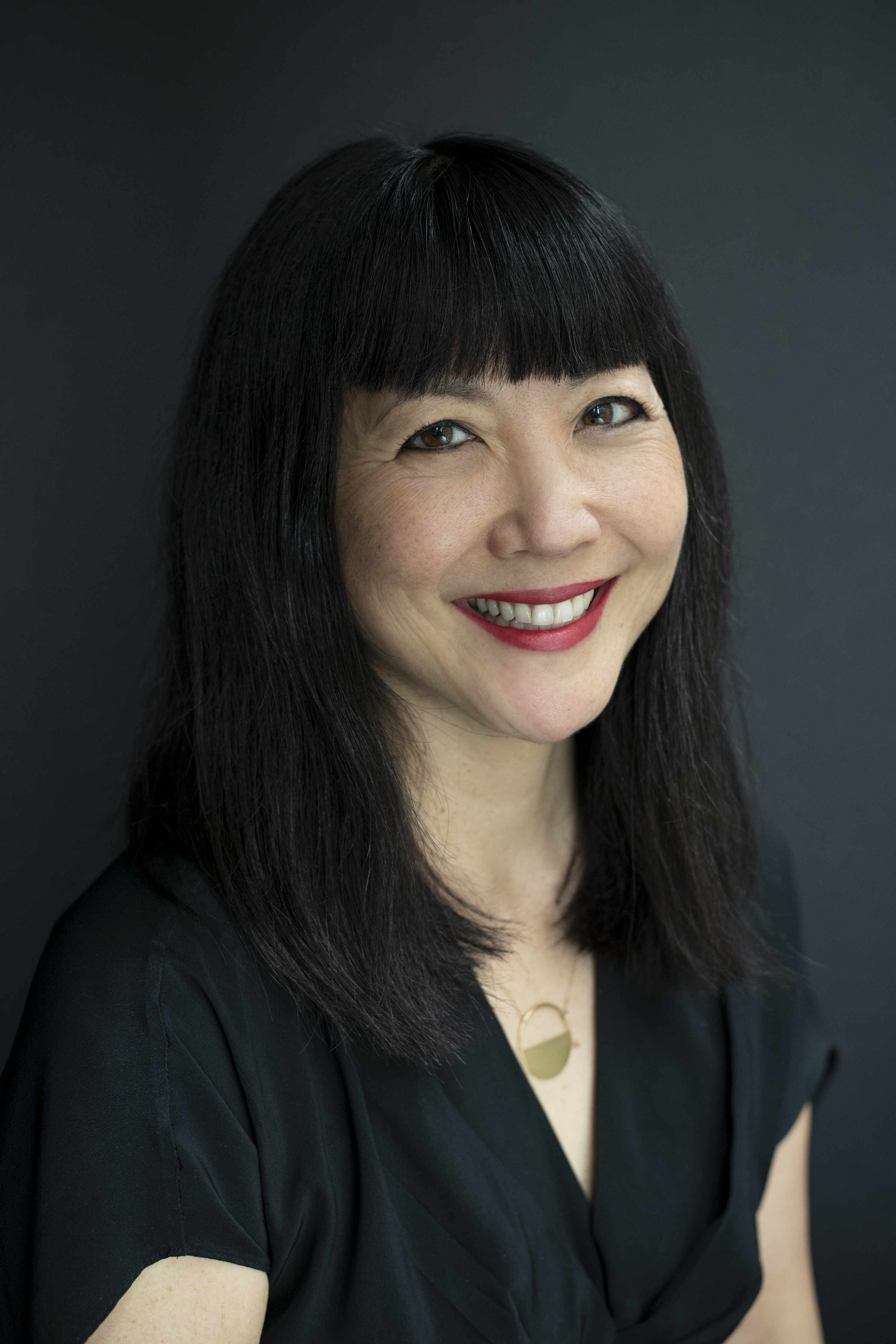 A color portrait of Miya Osaki.