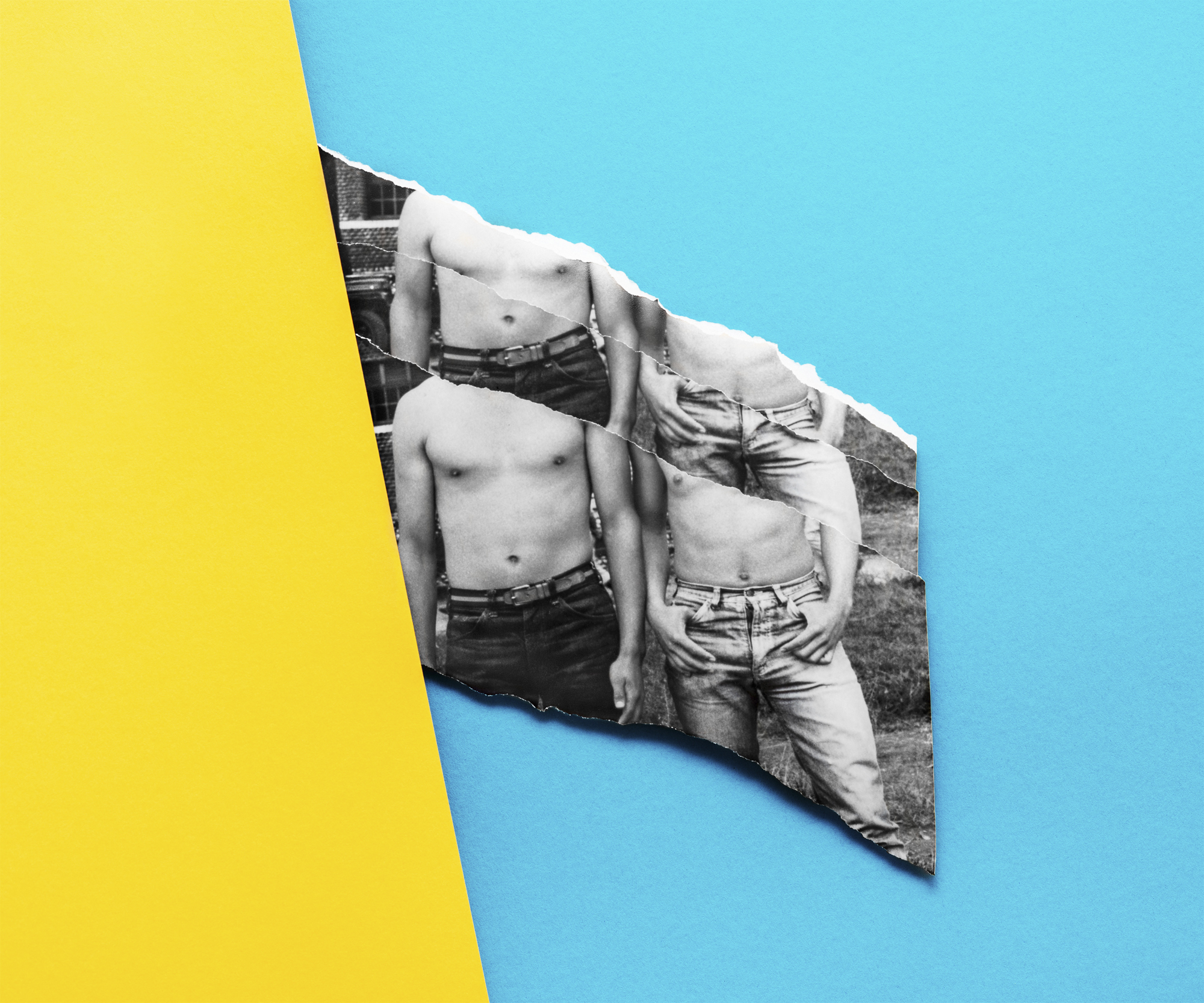 "<p ""="""">A collage incorporating torn photographs of two shirtless men and bright yellow and blue construction paper.<span class=""redactor-invisible-space""></span>"