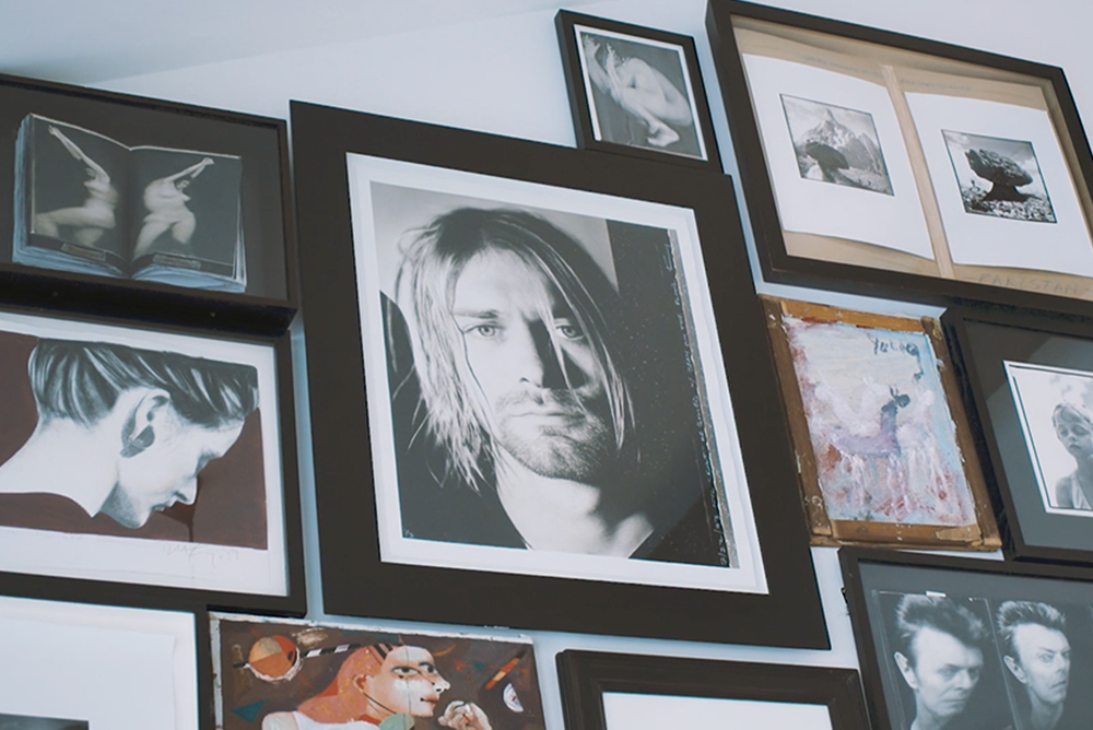 framed pictures of musicians and celebrities