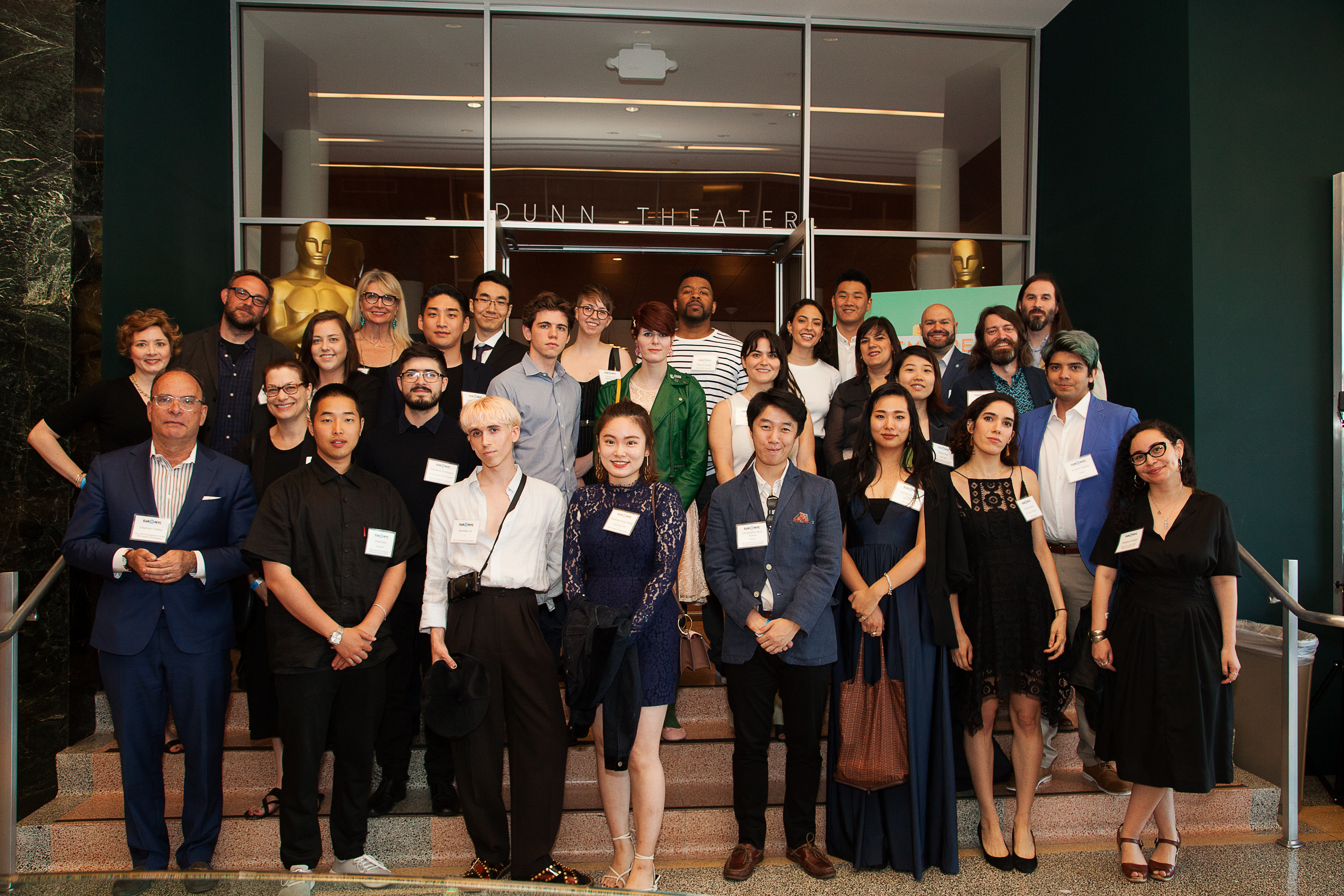 Recent graduates and SVA faculty and staff pose before the SVA Premieres screening on May 31.
