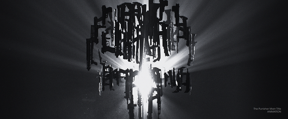 Guns hanging in a circle from a dark ceiling with a light coming from the middle.
