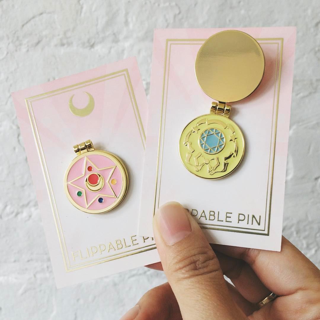 A set of sailor moon themed pins.