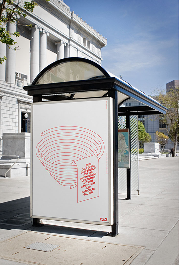 The side of a bus stop which and advertisement showing.