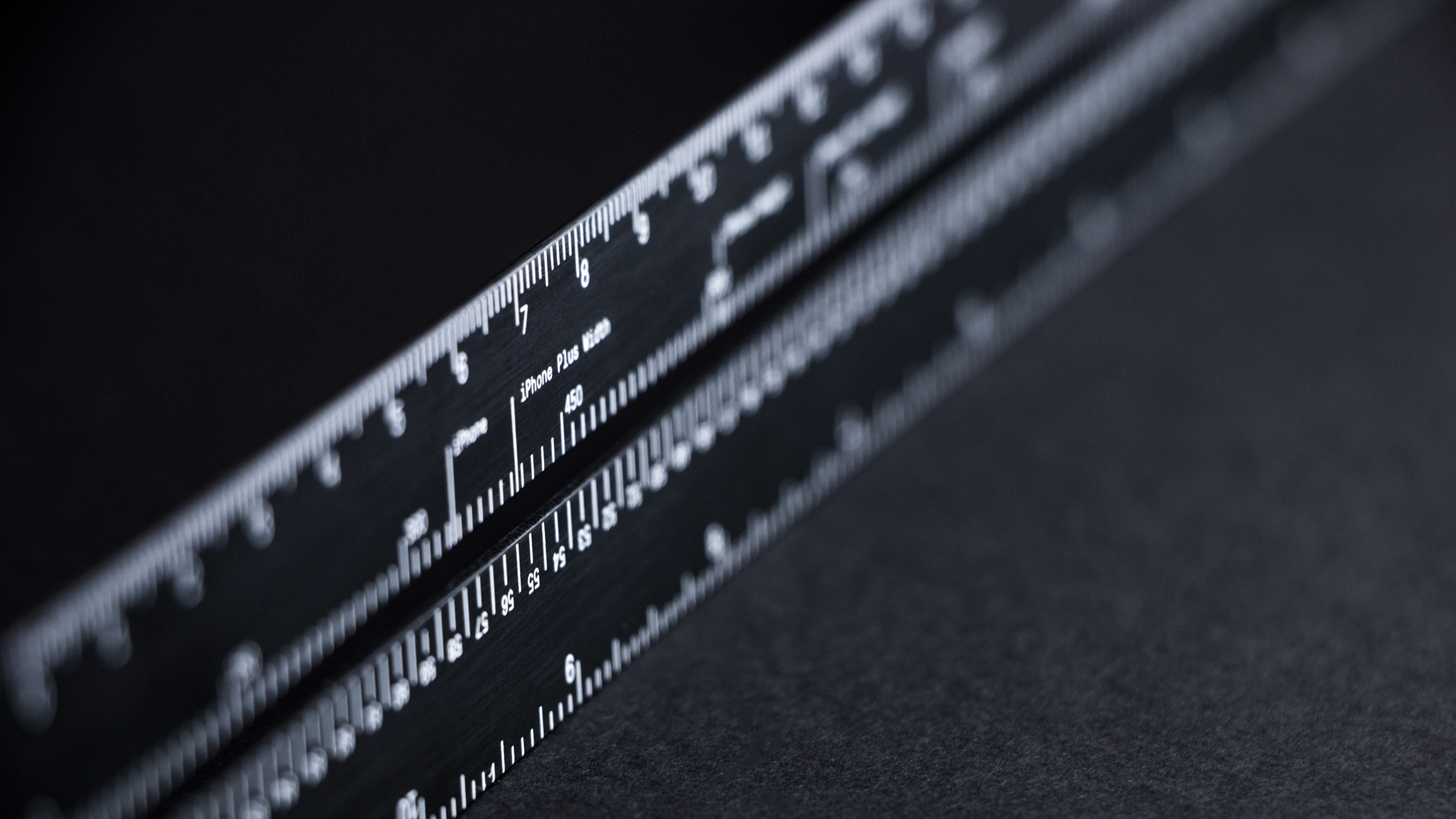 two black instruments that measure inches