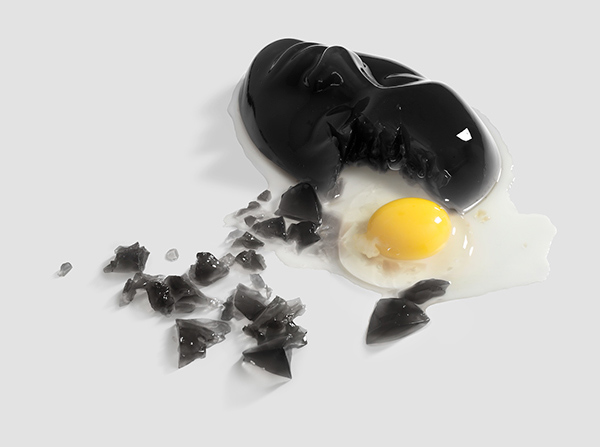 a fried egg coming out of the forehead of a black mask
