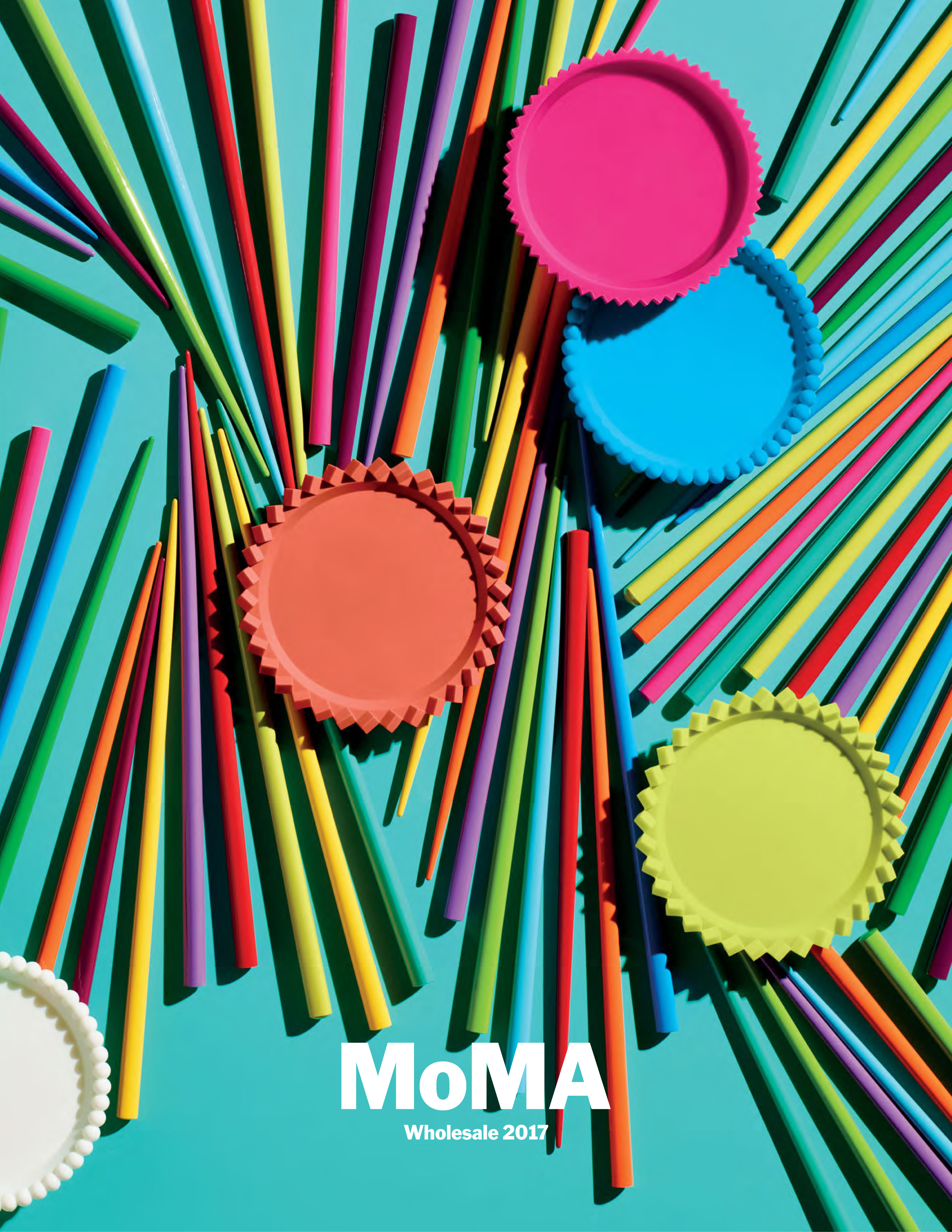 MOMA Wholesale 2017 poster with brightly colored sticks and round shapes on a cyan background.