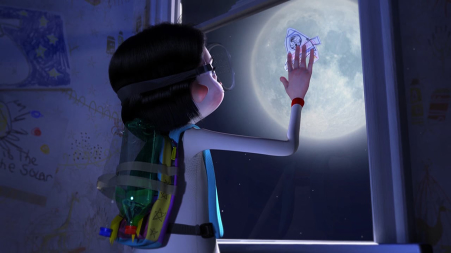 Boy in make shift space suit costume touches window while looking at the moon