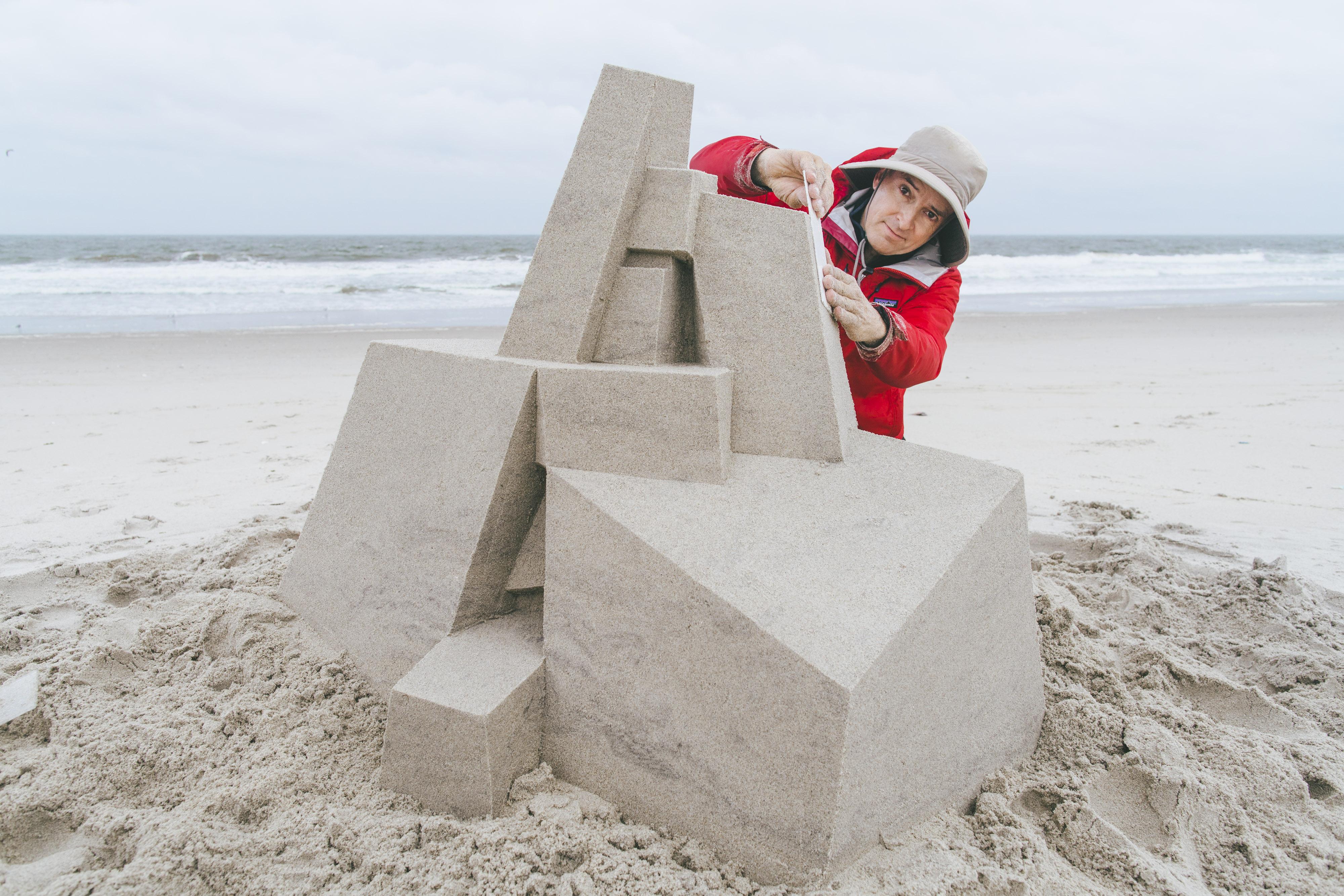 "<p ""="""">SVA alumnus Calvin Seibert puts the finishing touches on a sandcastle sculpture at Rockaway Beach, Queens."