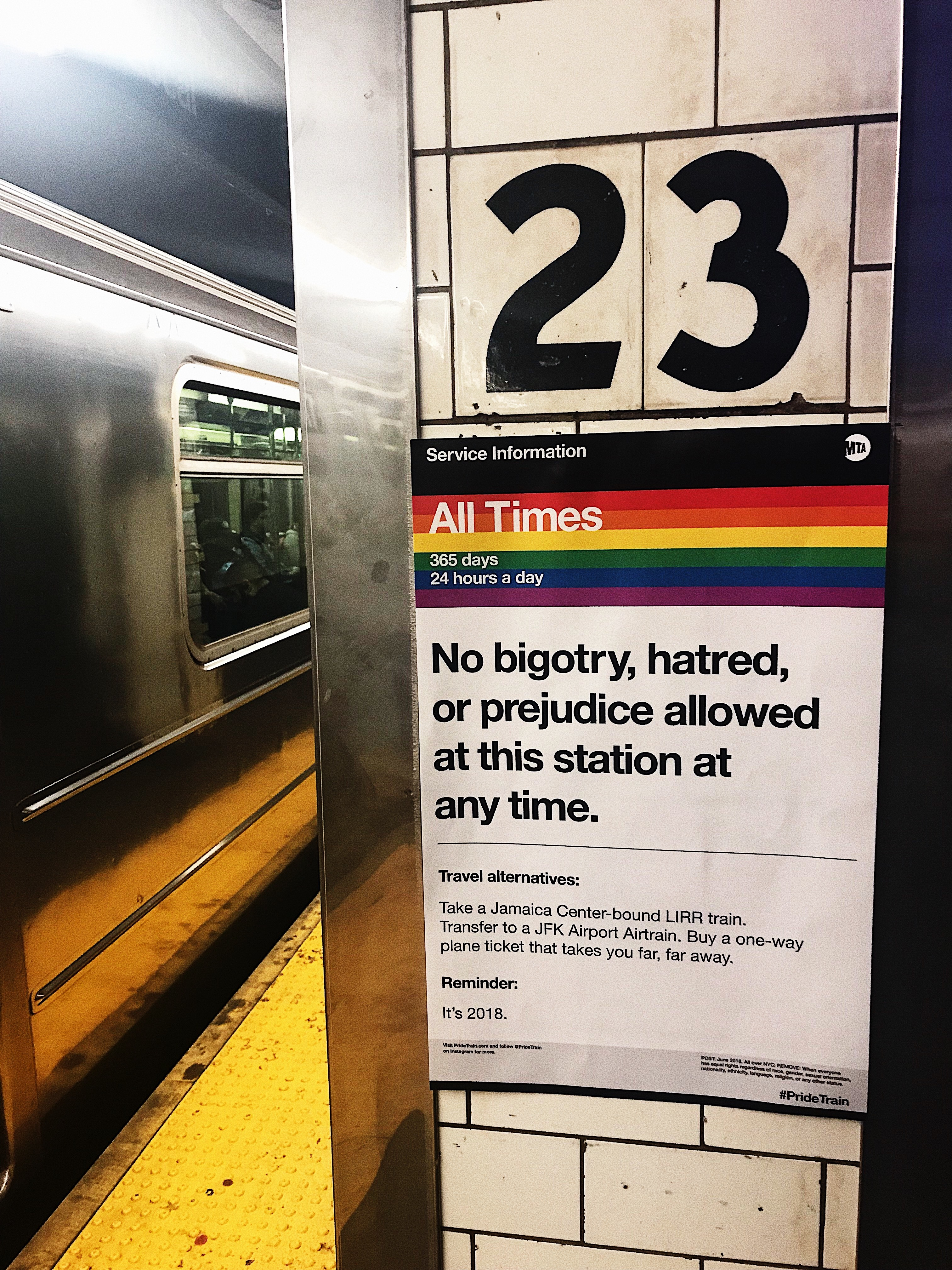 A Pride Train poster at the 23rd street R/W stop