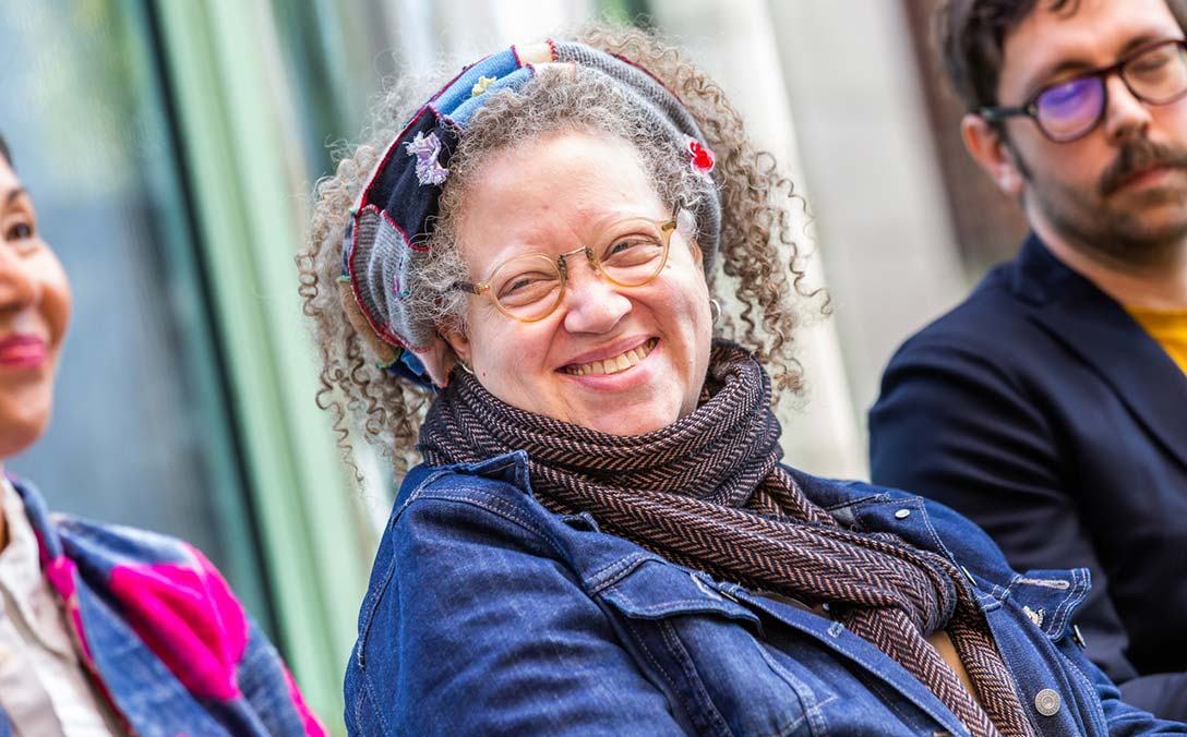 Gail Anderson smiles and looks to her right during a panel discussion.