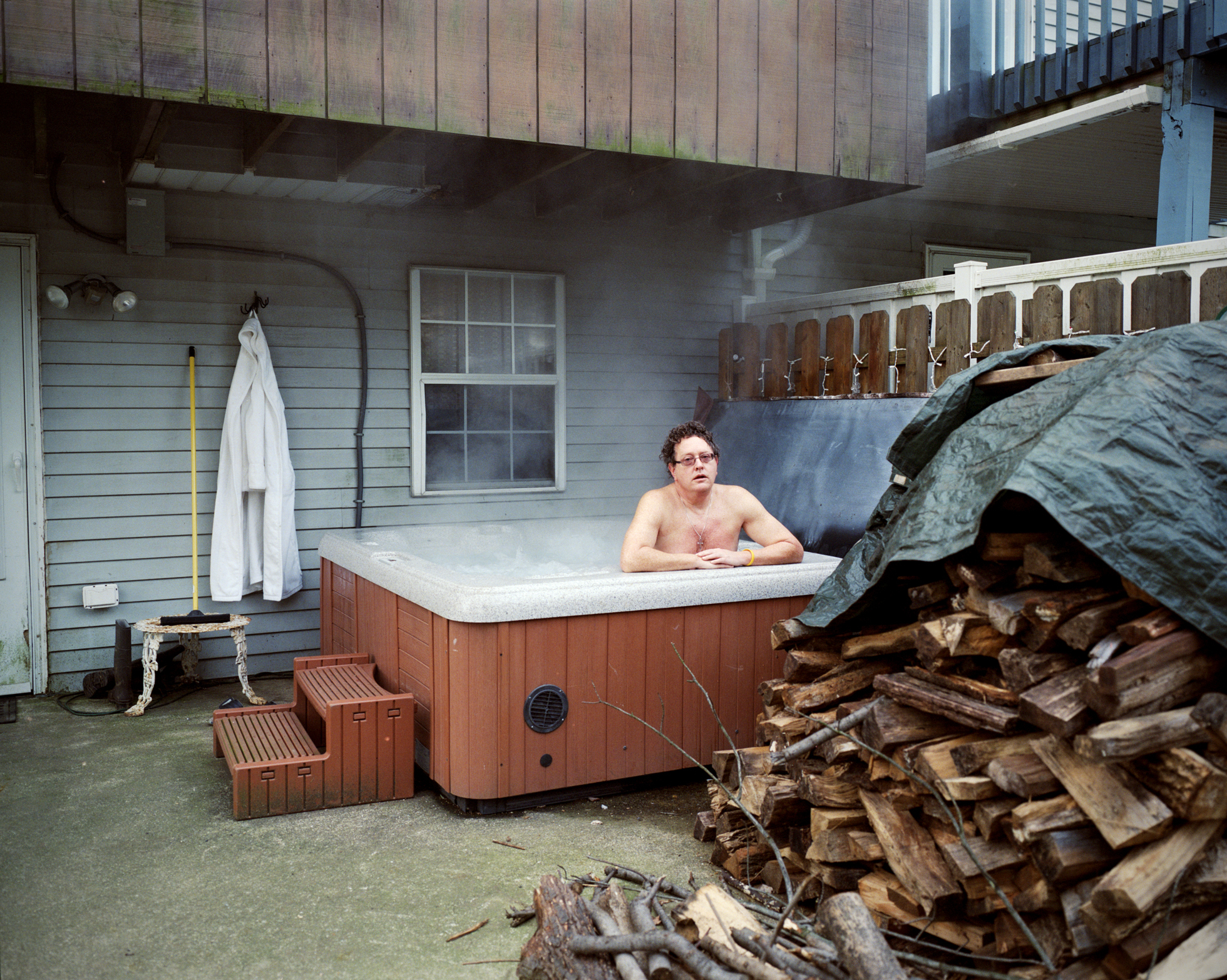 A picture of a guy inside a jacuzzi