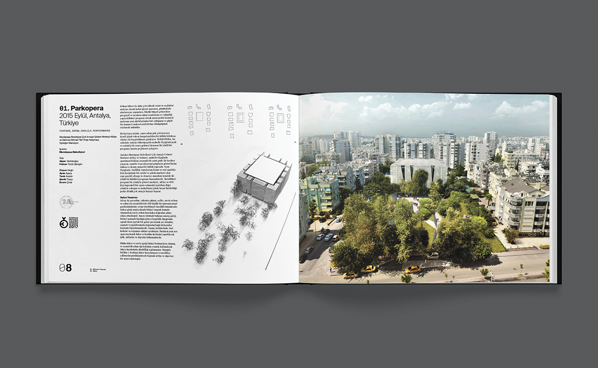 A photograph of a book filled with images of landscapes and buildings.