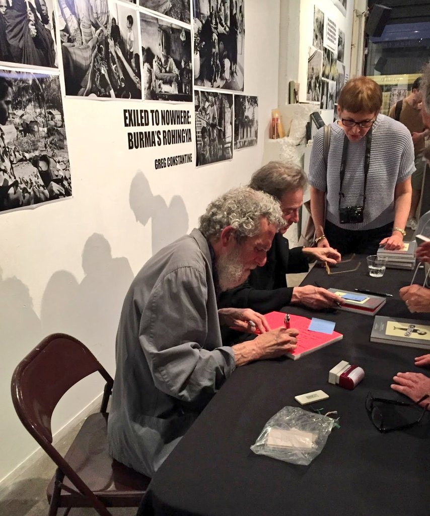 """An image of Carl Titolo and Richard Lewis at a book signing for their collaborative novel """"Reflections From Hell."""""""
