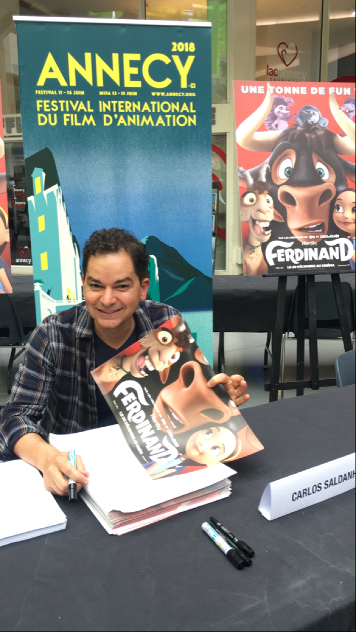 A photo of alumnus Carlos Saldanha at a poster signing for his animated movie <em>Ferdinand</em> by Chloe Esposito courtesy of Blue Sky Studios.