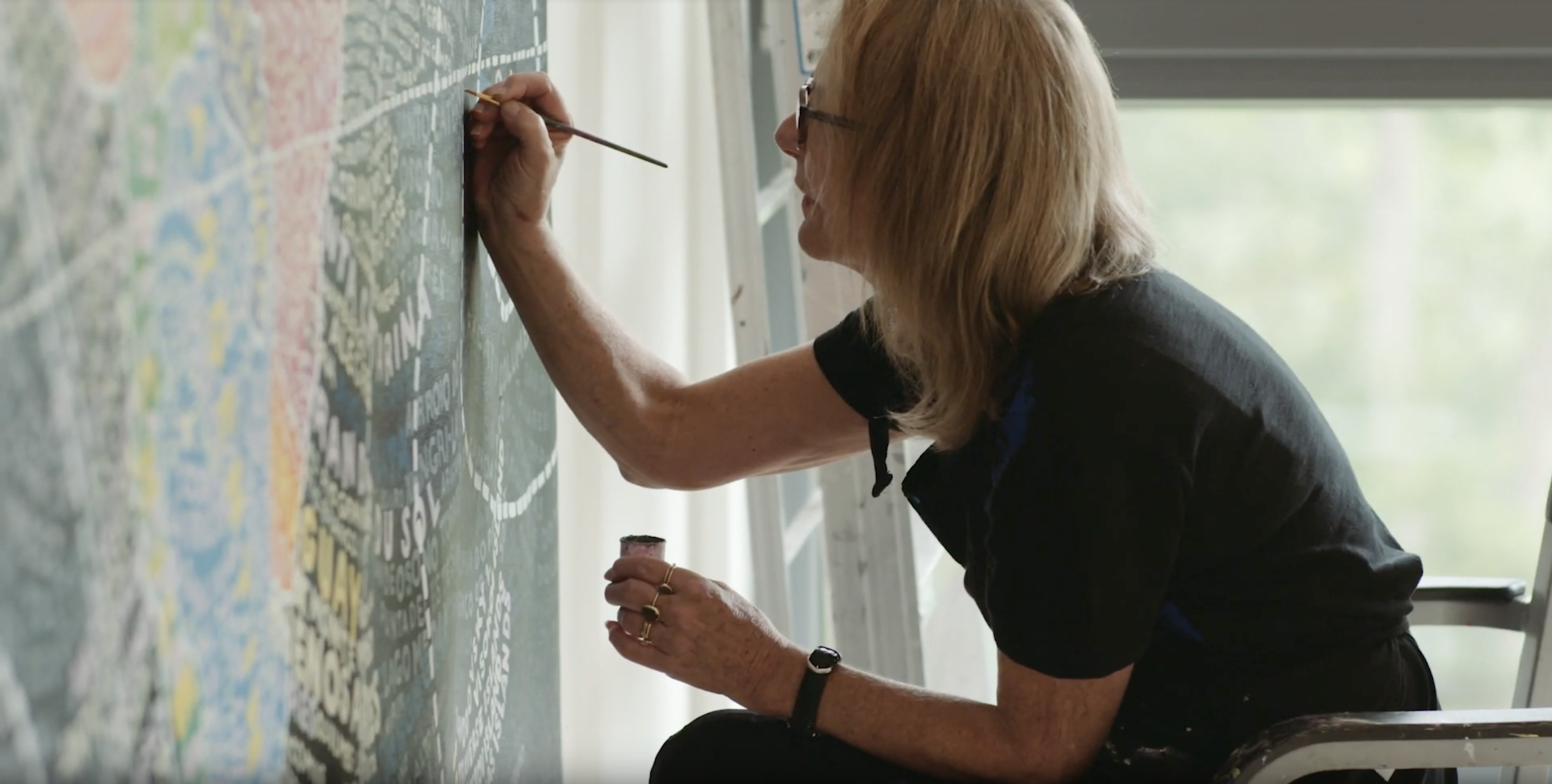 """<p """"="""""""">Paula Scher works on one of her oversized map paintings."""