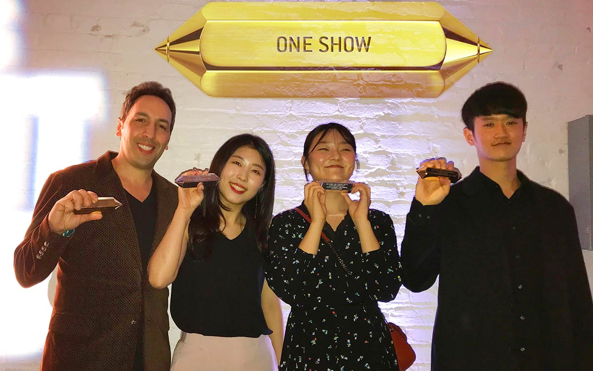 """BFA Advertising faculty Frank Anselmo and Young Ones award-winning students Sujin Lim, Taekyoung Debbie Park, Eunseok Park<span class=""""redactor-invisible-space"""">. <em></em></span>"""