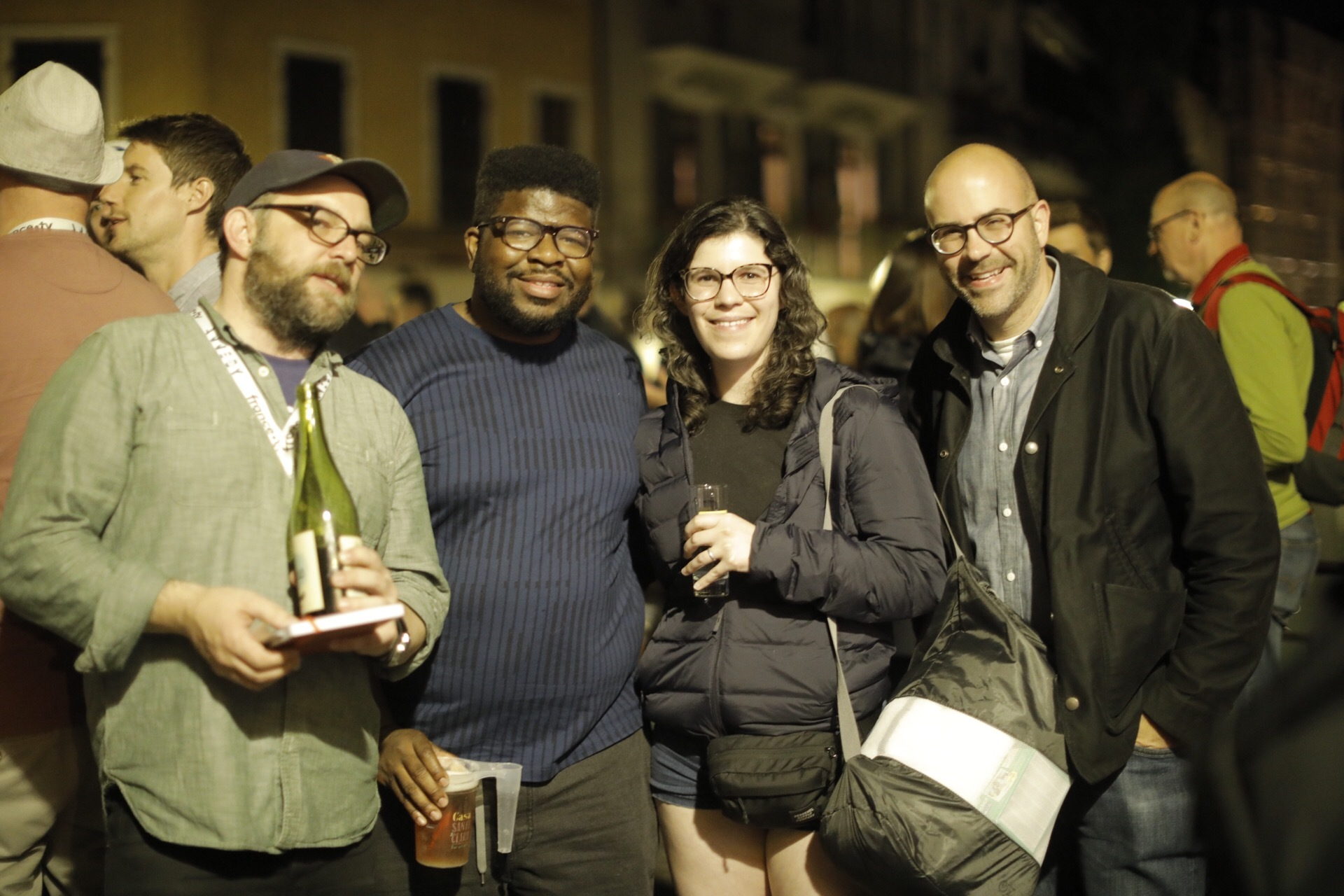 A group of people pose for a photograph.