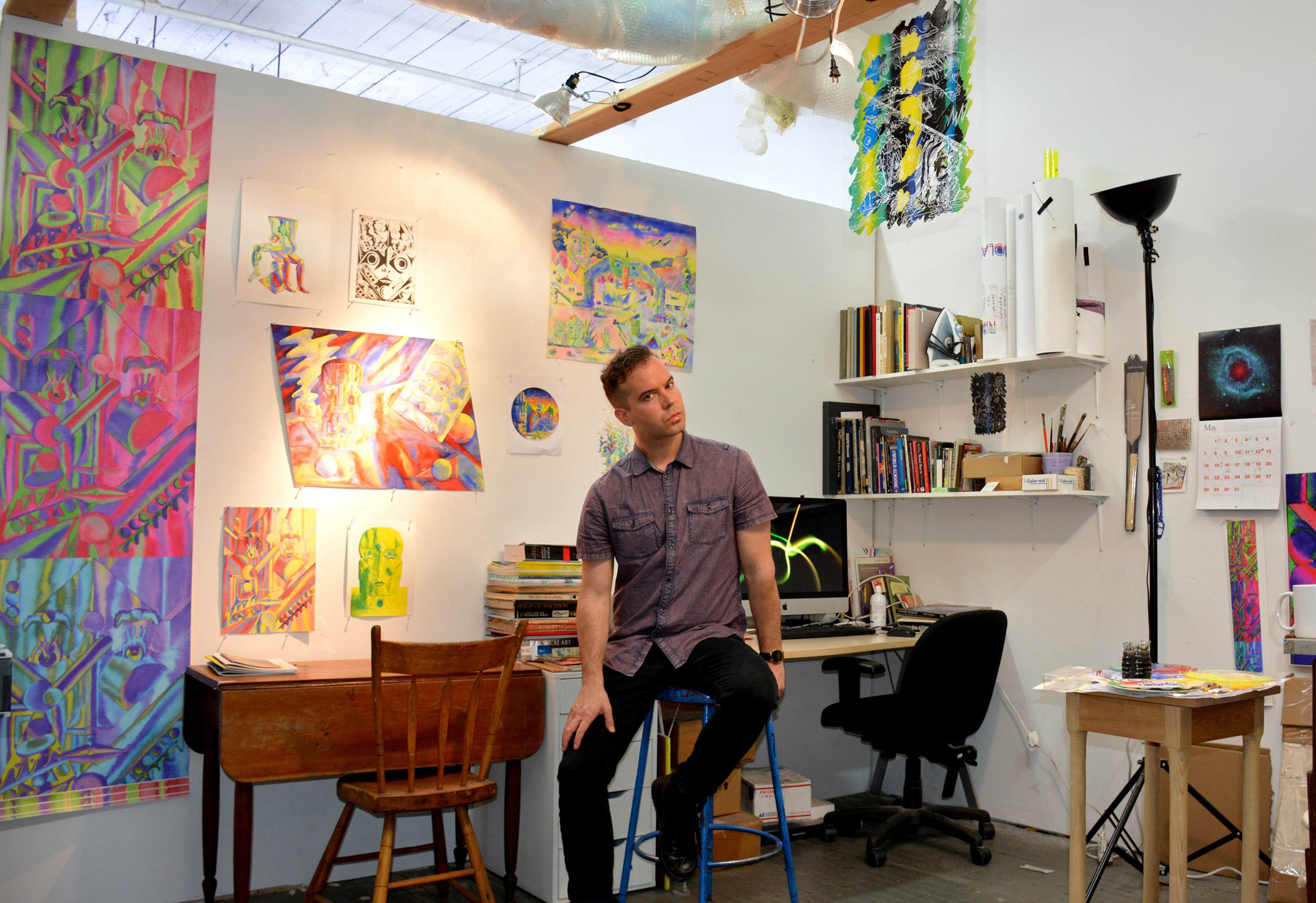 "<p ""="""">The artist Pan Terzis sits in his art studio, surrounded by paintings and prints."