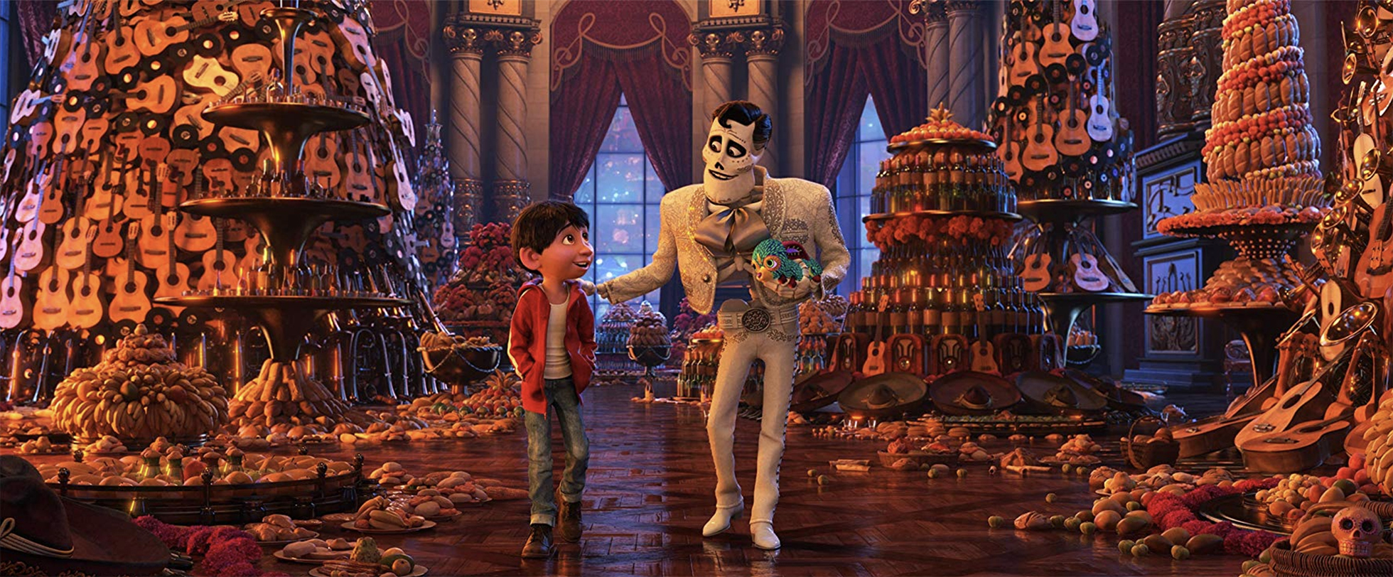 still from Coco of Miguel with the man who he believes to be his father in a room absolutely filled with guitars.