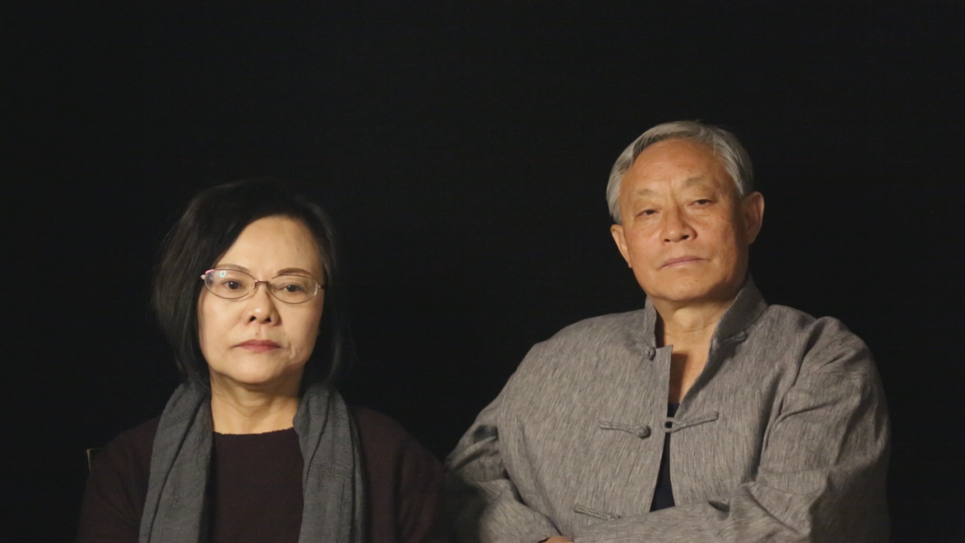 A medium portrait of the filmmaker's parents, looking into middle distance.
