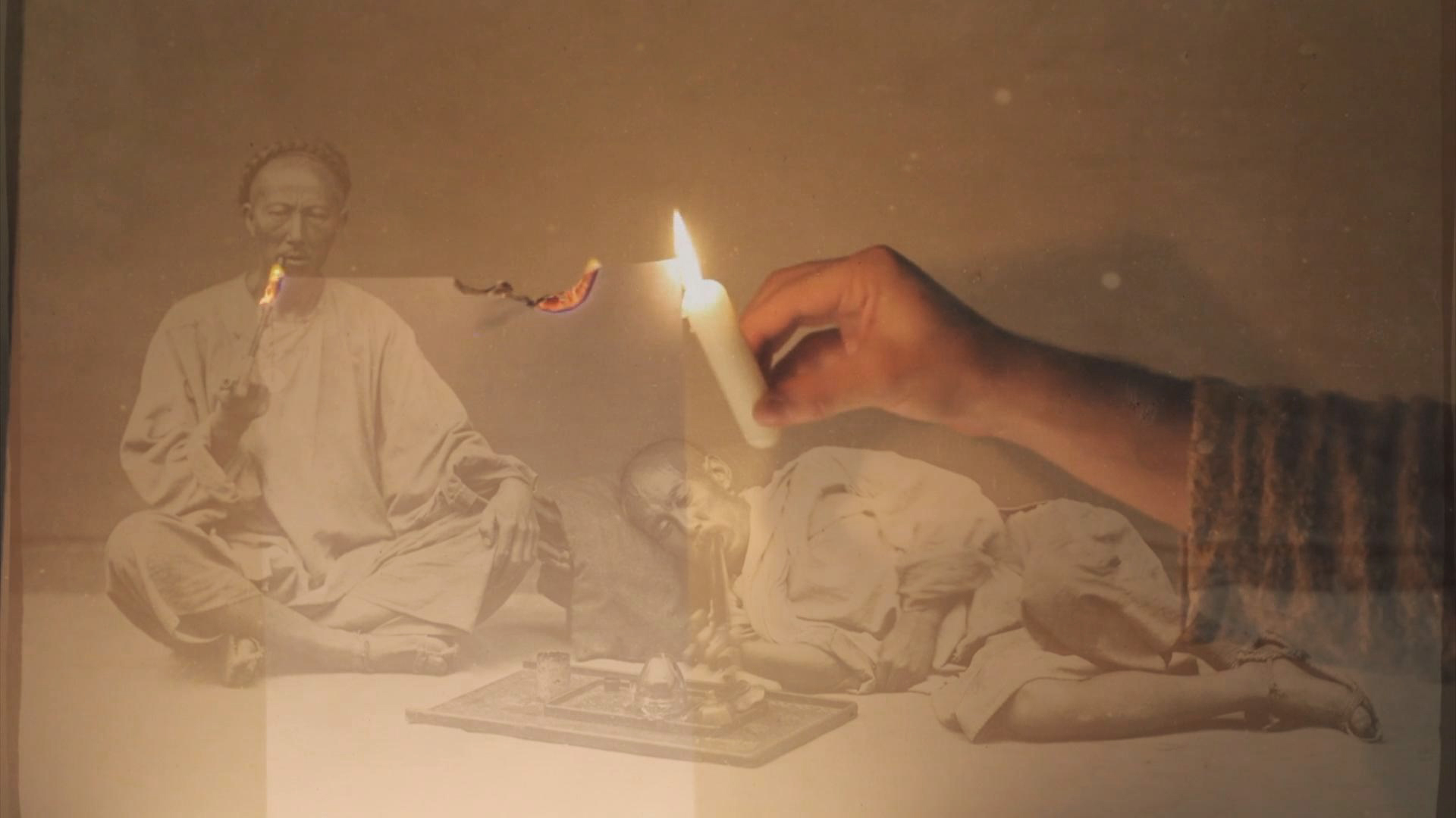 A hand holding a candle burns a piece of paper. Superimposed across the image is a 19th century B&W photograph of Chinese men smoking opium.